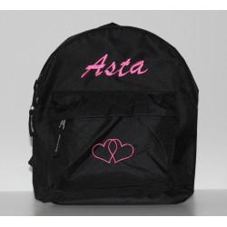 Sort pige rygsæk med navn på. god som børnehavetaske.